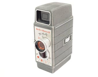 Bell and Howell Two Twenty 8mm movie camera with film inside