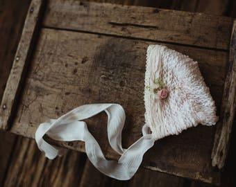 Dainty soft pink NB bonnet.