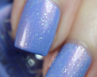 "Nail polish - ""Traverse The Skies"" A purple with green to pink shifting shimmer and glitters"