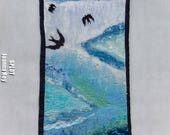 blue felted wall hanging swallows on the sky
