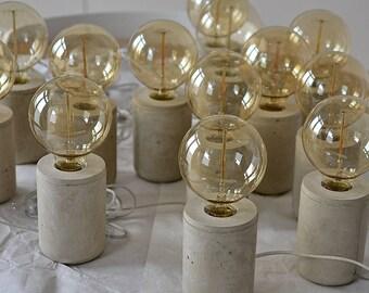 Concrete lamp. Concrete table lamp with warm light of vintage Edison bulb
