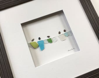 Pebble Art by Sharon Nowlan, laundry sea glass and pebble art comes matted or framed in 12 by 12 frame.