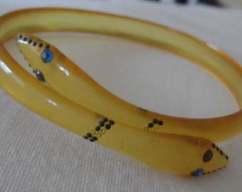 1920's double headed snake bangle with blue paste eyes