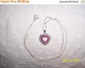 TWICE A YEAR, 25% Off Vintage Natural Rubies and clear cubic zirconias heart pendant with chain. Sterling silver.