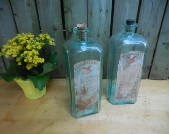 Antique Max Huncke Red Falcon Embalming Fluid Bottles with corks