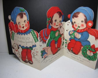 Adorable 1940's-50's die cut Rust Craft juvenile christmas card for a fine boy 3 panels of boys playing instruments, Marjorie Cooper?