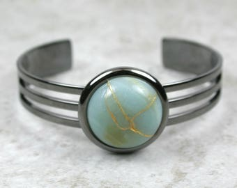Kintsugi (kintsukuroi) cuff bracelet with amazonite stone cabochon with gold repair in a gunmetal black plated setting - OOAK