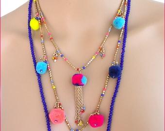 Collier-Sautoir multicolore - Chaine , perles cristal bleu/Indigo et pompons