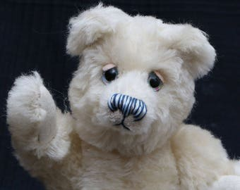 Izzy is one of our old bears, he's a sweet and chirpy, traditional teddy bear made from gorgeous English mohair by Barbara Ann Bears