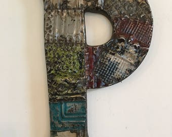 "Patchwork letter ""P"" designed with antique tin ceiling tile"