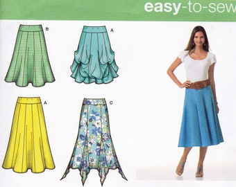 Simplicity 2449  pattern, uncut, six versions of misses' gored skirts in sizes 14-22