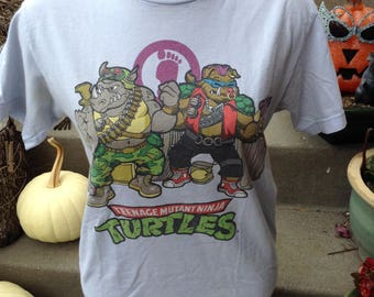 Vintage Teenage Mutant Ninja Turtles Rocksteady and Bebop tshirt size small free domestic shipping essential for TMNT fans