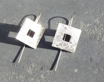 Sterling Silver square stud earrings.