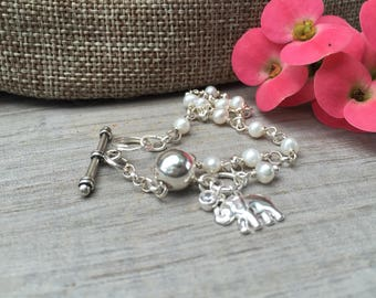 Elephant charm bracelet. Sterling silver and mini white pearls.