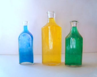 Three small vintage bottles