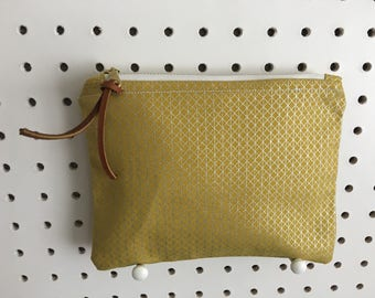 Yellow Zipper Pouch with Metallic design and leather pull