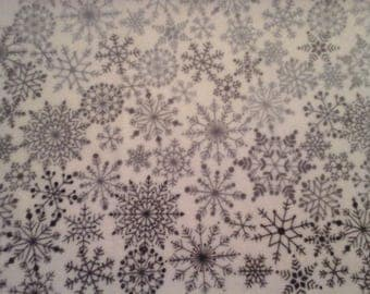 Double kitchen towel extra wide with shades of gray snowflakes. Crocheted gray top.