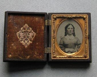 One-Ninth Plate, Hand-tinted Ambrotype of Young Girl in Elaborately Detailed Union Case