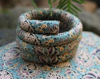 New - Subtle pretty soft paisley design SpiraLock. Vegan. Original bendable dread tie to wrap and secure your locks