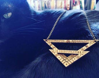 Laser cut necklace with engraved symbols