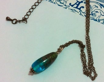 Necklace turquoise blue glass bead transparent and glitter gold/bronze