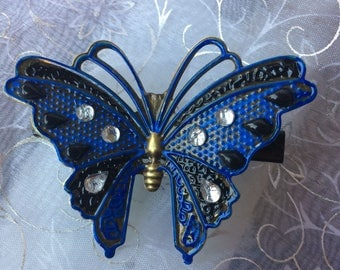 Hand painted blue and black butterfly with gems on black alligator clip