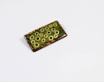Brooch, enamel on copper, multicolored with gold.