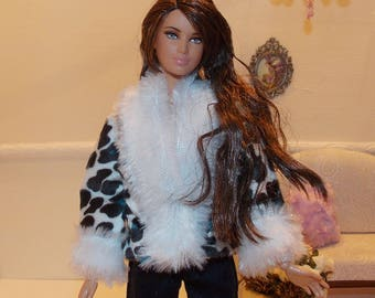 Coat only.  Handmade, Lined Jacket with a snap.   (This listing is for the Coat only.  Barbie Doll and Pants are not included)