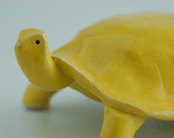 Turtle, ceramic, yellow glaze on white stoneware, indoor,outdoor sculpture
