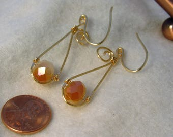 Spiral wire wrapped hammered earrings gold orange dangle glass bead earrings
