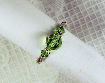 """Cynthia Lynn """"CELEBRATE"""" Swarovski Crystal Peridot Green August Birthstone Silver Stretch Ring"""