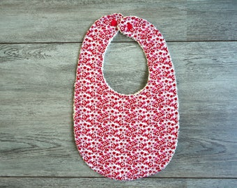 Bib with red flowers