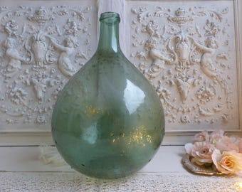 Antique french green glass demi john bottle. Mouth blown glass demi john. Green glass. French wine storage bottle. French country