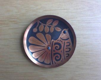 vintage copper coloured bird plate