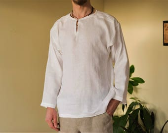 Ethnic white linen shirt with hand embroidery.