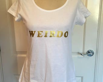 White womens tshirt with weirdo in gold lettering 14/16