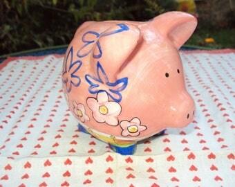 Painted ceramic pig piggy bank.
