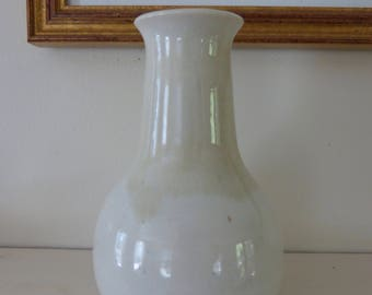 Small white ceramic vase.