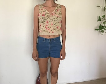 Floral top size medium fits like a crop top