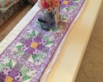 Purple, green, and yellow quilted table runner