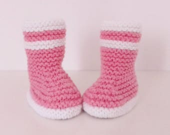 Let us put on bootees babies birth in 12 pink and white woolen hand-knitted months