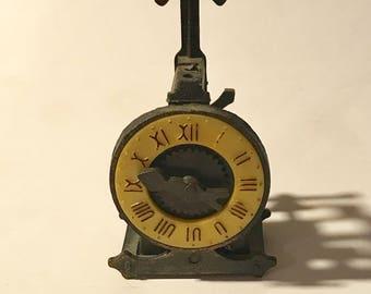 Vintage die-cast Pencil sharpener old time clock