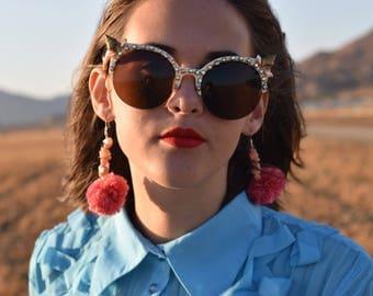 Seashell and rhinestone embellished sunglasses