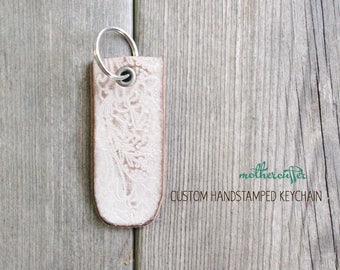 CUSTOM HANDSTAMPED distressed white leather keychain by mothercuffer