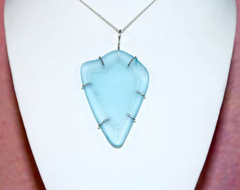 """Large Free Form Sky Blue Sea Glass in a Sterling Silver Wire Cage Setting. 16"""" Sterling Silver Chain & Gift Packaging Included."""