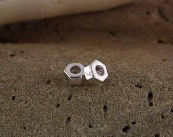 Silvery metal nut bead