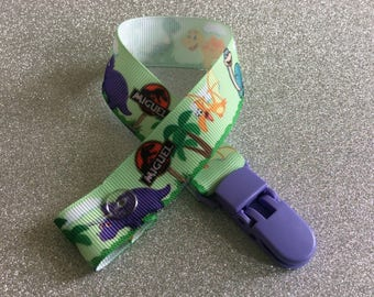 "Cute dinosaurs with""Miguel"" sign grosgrain ribbon dummy clip"