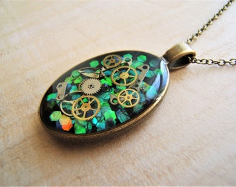Iridescent necklace Steampunk pendant. Cogs, genuine vintage watch parts. Handmade.