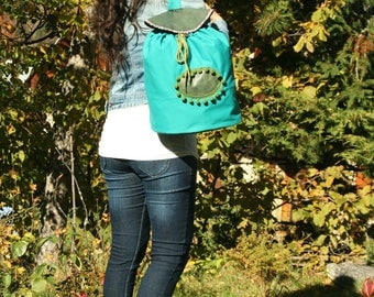 Green fabric and leather backpack