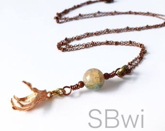 Dragon claw necklace in copper and rose gold with dragon's vein agate detail